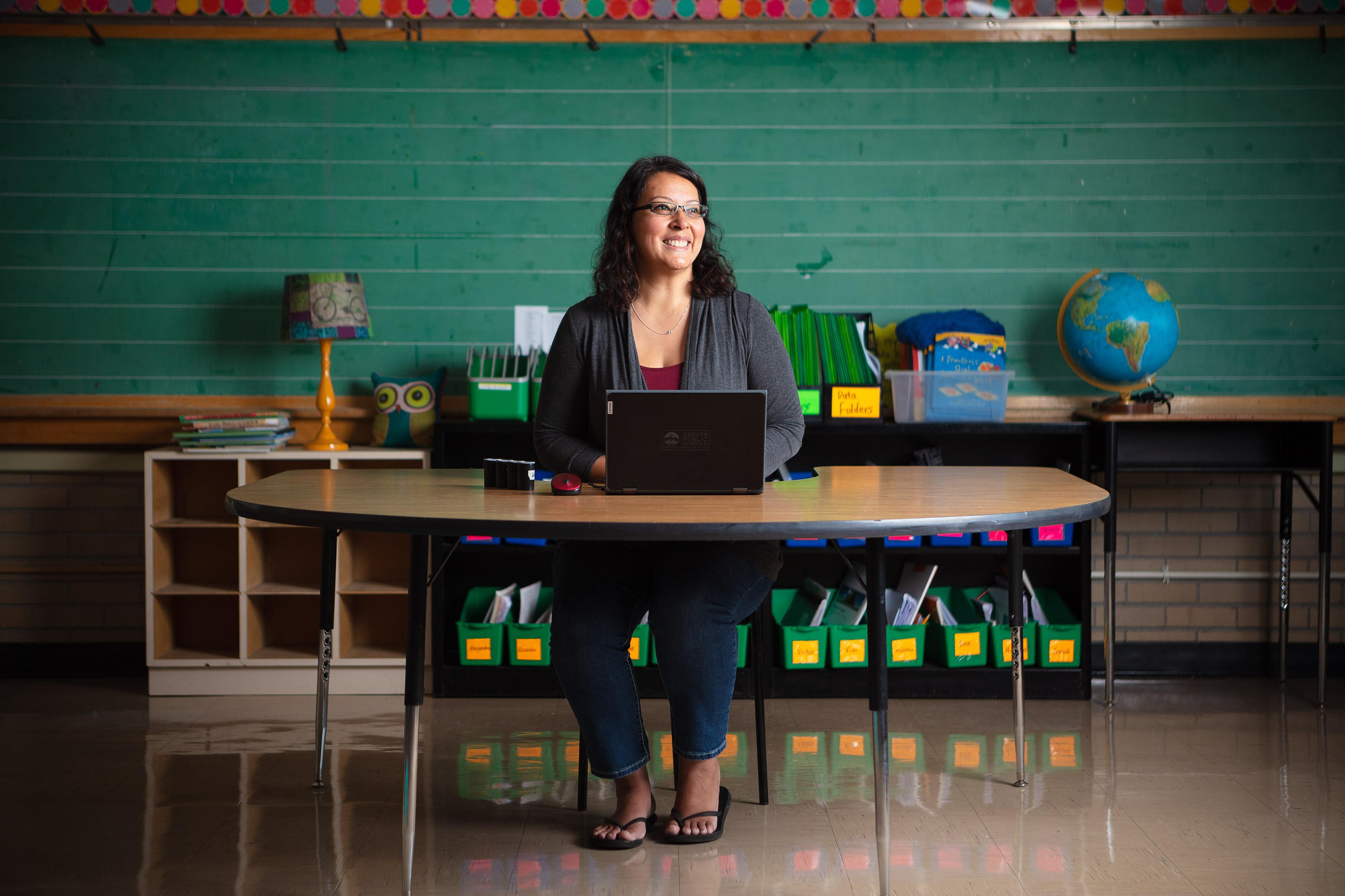 denver teacher sits at her desk preparing for covid school year