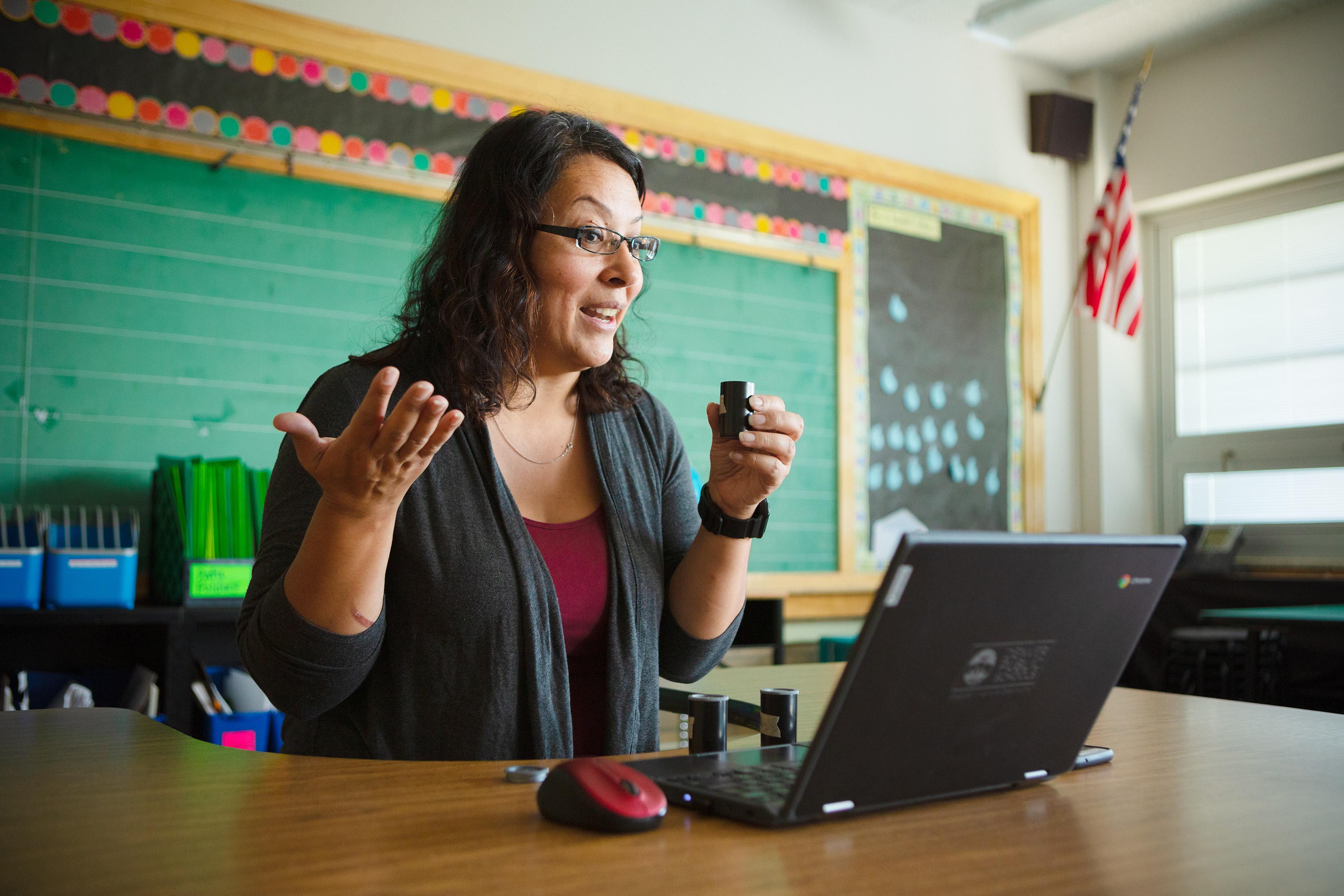 A denver teacher creates videos for virtual students during covid