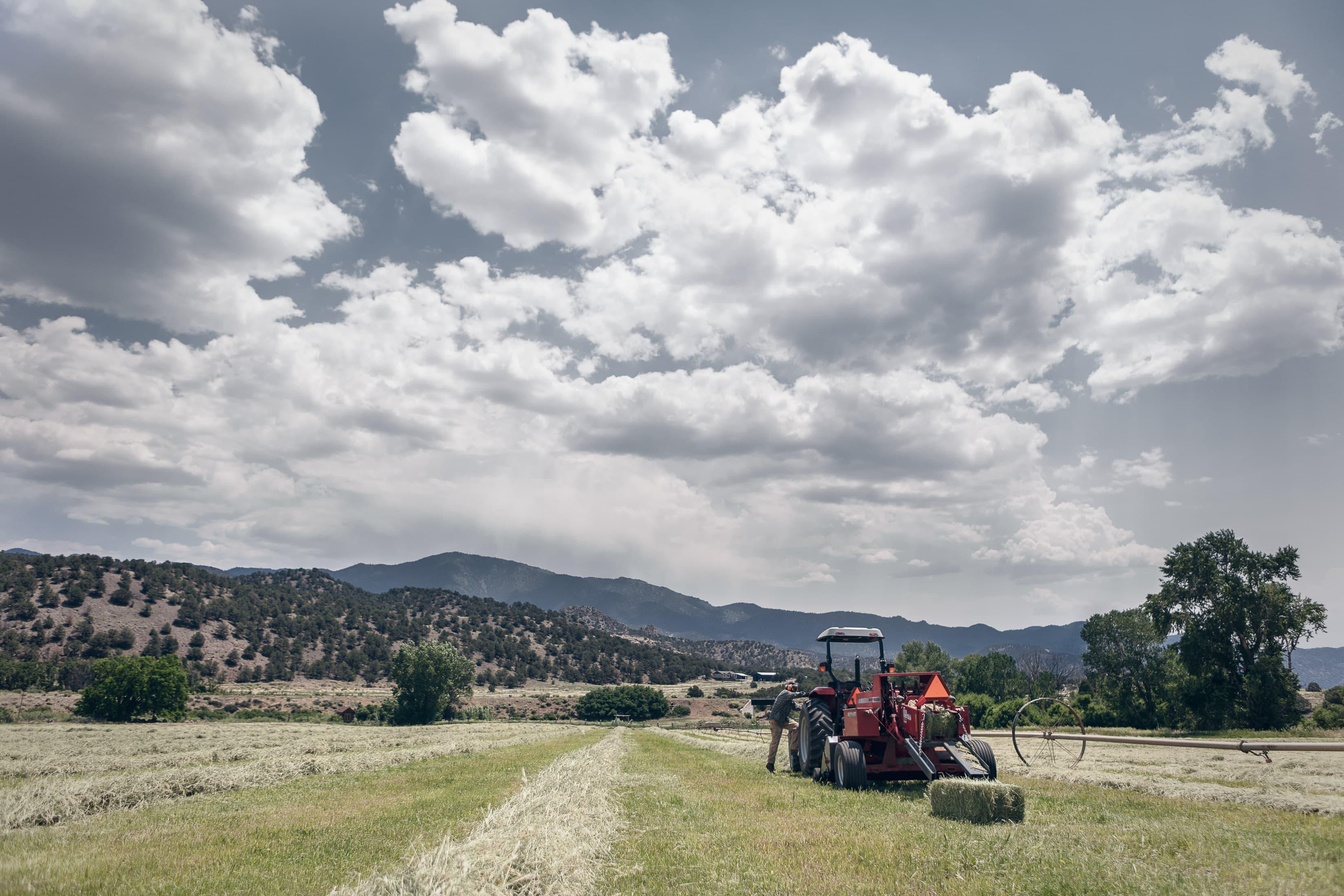 a man gets into a hay tractor in howard colorado