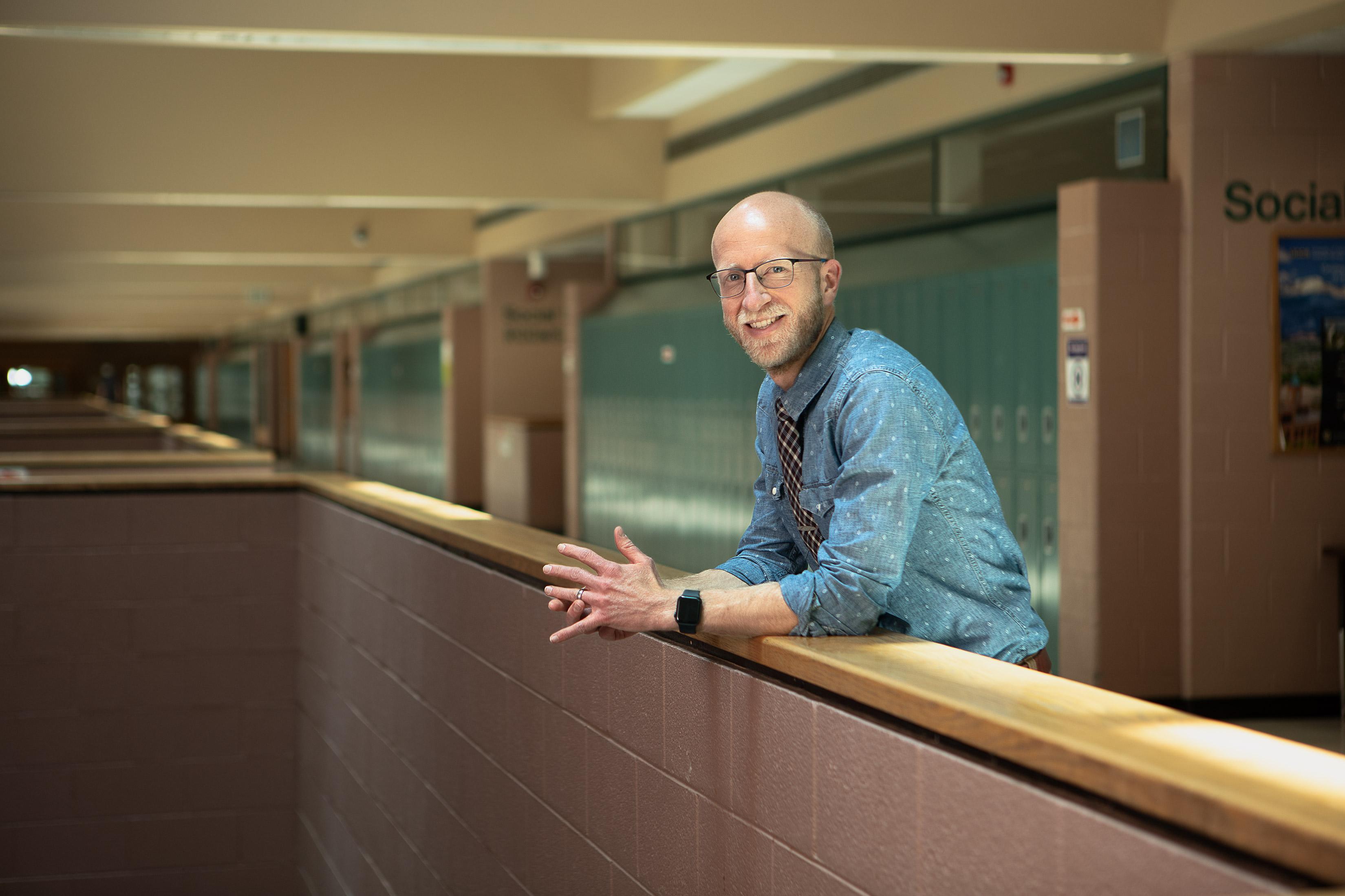 portrait photography of denver teacher in his classroom