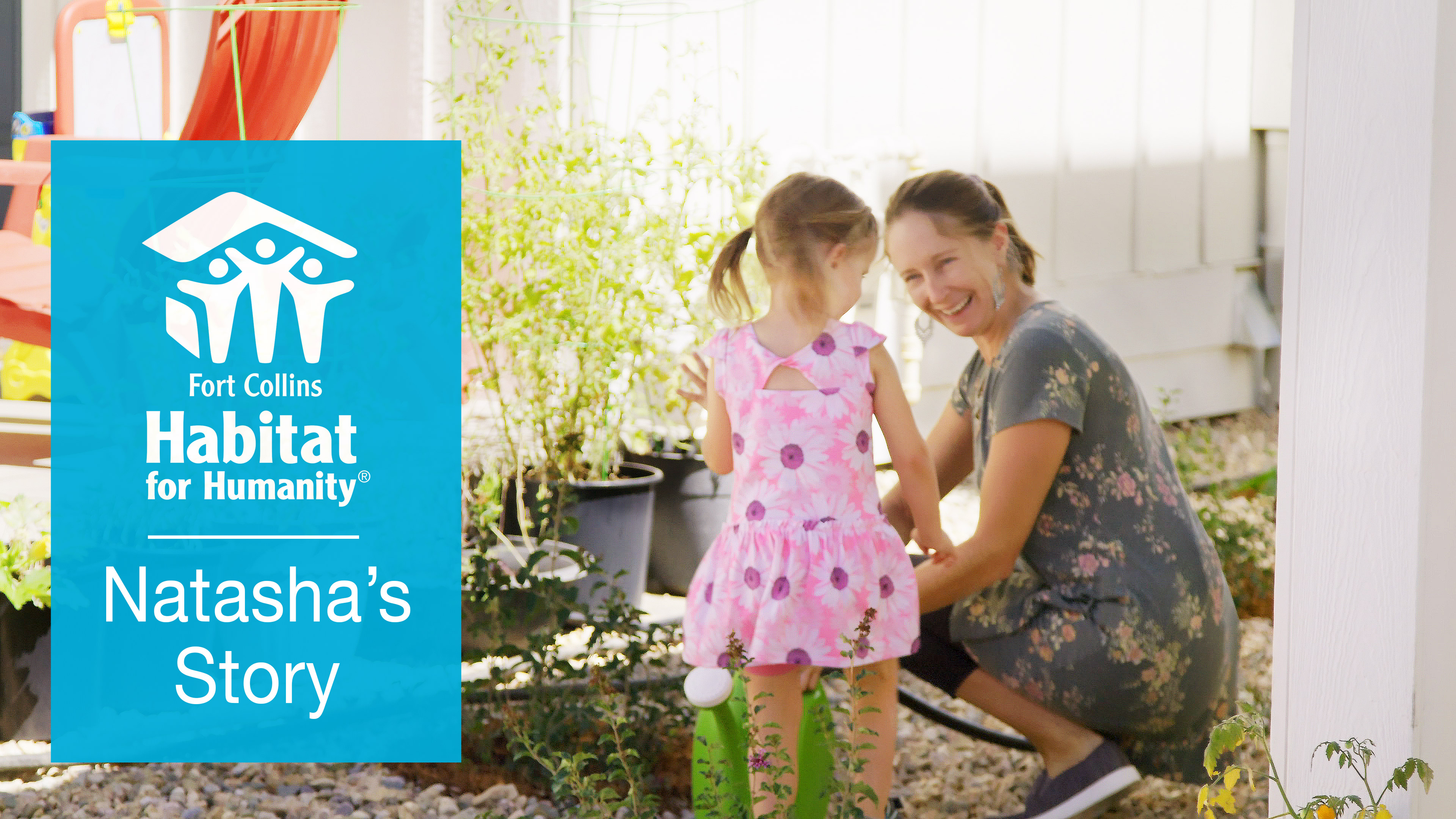 A Mom And Her Daughter Water Plants At Habitat For Humanity House