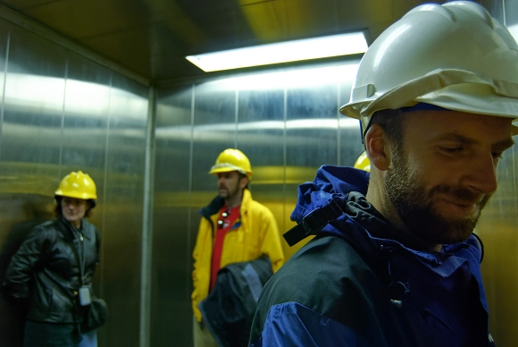 construction workers in elevator