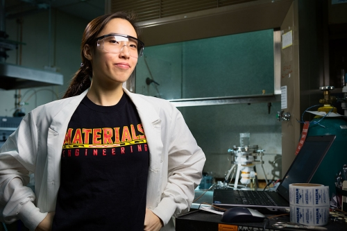 engineering student poses in her lab for a portrait